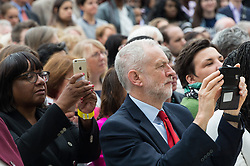 © Licensed to London News Pictures. 24/04/2018. London, UK. © Licensed to London News Pictures. 24/04/2018. London, UK. DIANE ABBOTT MP and JEREMY CORBYN MP, Leader of the Labour Party <br /> use their mobile phone at the statue unveiling of the Suffragist leader Millicent Fawcett in Parliament Square. The Mayor of London commissioned Turner prize-winning artist GILLIAN WEARING OBE to create the statue. Photo credit: Ray Tang/LNP