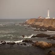 A motorcyclist rides his bike on Pacific Coast Highway in Caspar, California on September 10, 2013. (AP Photo/Alex Menendez)