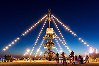 Night at the Climb In by: Dustin Weatherford from: Reno, NV year: 2018<br /> Night at the Climb In will be a 70 foot tall stack of reclaimed junkyard cars, stacked straight up, one on top of the next. Every car will be climbable, visitable, interactive in its own way. The stack will end in a crows nest that sits at the top of the structure, just under a large spinning lit up sign.<br /> URL: https://www.facebook.com/nightattheclimbin/