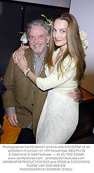 Photographer DAVID BAILEY and his wife CATHERINE at an exhibition in London on 19th November 2002.PFJ 22