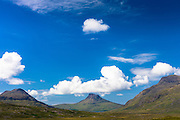 White puffy Cumulus clouds over Stac Pollaidh, Stack Polly, mountain within West Highlands Geopark part of Inverpolly National Nature Reserve in Coigach region of Scotland