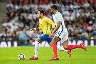 Brazil (10) Neymar, England (4) Joseph Gomez during the International Friendly match between England and Brazil at Wembley Stadium, London, England on 14 November 2017. Photo by Sebastian Frej.