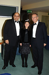 Left to right, NAYNESH DESAI, MISS KARMI PINNING and LORD ARCHER at the charity Vanishing Herd Foundation - Conservation Ball held at the Radison Hotel, Portman Square, London on 13th November 2004.<br />