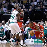 06 March 2012: Houston Rockets point guard Kyle Lowry (7) drives past Boston Celtics small forward Mickael Pietrus (28) on a screen set by Houston Rockets power forward Patrick Patterson (54) during the Boston Celtics 97-92 (OT) victory over the Houston Rockets at the TD Garden, Boston, Massachusetts, USA.
