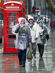© London News Pictures. 25/04/2012. London, UK. A group of women battle through heavy rain in central London on April 25, 2012. Photo credit : Ben Cawthra /LNP
