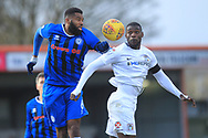 Ethan Ebanks-Landell wins a header during the EFL Sky Bet League 1 match between Rochdale and Coventry City at Spotland, Rochdale, England on 9 February 2019.
