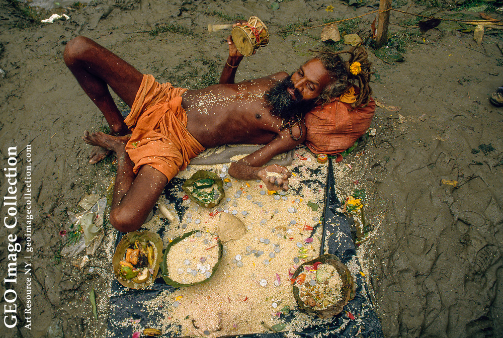 This picture of a man who appears to be a guru, sadhu, or yogi was taken during the Gokarna Aunsi (Father's Day) Festival at the temple nine kilometers northe ast of Kathmandu called Gokarneswar, or Lord Shiva of Gokarna.  In the course o f this festival 10,000 people come to bathe in the Baghmati River and do puja for thei r fathers.