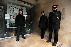 © Licensed to London News Pictures. 21/01/2012, London, UK. Police stand at the front entrance to the building. Occupy London protesters this morning publicly repossessed Roman House, an abandoned nine-storey office building in the Barbican. The Occupy London campaigners - part of the global movement for social and economic justice and real democracy - stated that they intend to occupy the building - their fifth occupation - until such time as the City of London Corporation publishes full details of its City Cash Accounts.  Photo credit : Stephen Simpson/LNP