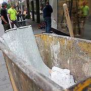 Businesses in Times Square clean up smashed windows in preparation for another expected night of protests due to the killing of George Floyd by a Minnesota Police Officer on Tuesday, June 2, 2020 in Manhattan, New York.  A citywide 8 p.m. curfew was ordered by NY Mayor Bill de Blasio amid the Floyd protests. (Alex Menendez via AP)