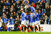 Andy Halliday of Rangers jumps on top of his team mates as Rangers start the 2nd half with a goal during the Ladbrokes Scottish Premiership match between Rangers and Motherwell at Ibrox, Glasgow, Scotland on Sunday 11th November 2018.