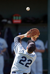 14 April 2013:  Luke Collins chases a foul pop up during an NCAA division 3 College Conference of Illinois and Wisconsin (CCIW) Baseball game between the Elmhurst Bluejays and the Illinois Wesleyan Titans in Jack Horenberger Stadium, Bloomington IL