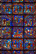 Medieval Windows of the Gothic Cathedral of Chartres, France, dedicated to the life of the Virgin Mary.   The bottom centre oval panel shows Anna and Joachim meet at the Golden Gate,  left Annunciation to Joachim , right Annunciation to Anna , above the nativity. Top centre oval shows the annunciation of the Virgin, left the marriage of Joseph and Mary, right the visitation below the virgin Matuy at school. Left side panels - bottom Anna and Joachim awaiting the birth of Mary above Her parents presenting the Virgin Mary to a schoolmaster . Right side panel, bottom - the first bath of Mary above Mary betrothal to Joseph after the test of the rods. A UNESCO World Heritage Site. .<br /> <br /> Visit our MEDIEVAL ART PHOTO COLLECTIONS for more   photos  to download or buy as prints https://funkystock.photoshelter.com/gallery-collection/Medieval-Middle-Ages-Art-Artefacts-Antiquities-Pictures-Images-of/C0000YpKXiAHnG2k