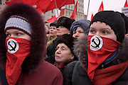 Moscow, Russia, 12/02/2005..Several thousand people demonstrate in central Moscow as part of a nationwide series of protests against recent social reforms which have replaced Soviet era benefits with cash payments. Masked young communist militants amongst the demonstration.