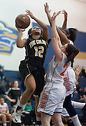 Kylie Covington #12 of The Colony drives to the basket against Frisco Wakeland at Little Elm High School on Friday, February 8, 2013 in Little Elm, Texas. (Cooper Neill/The Dallas Morning News)