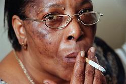 Portrait of woman smoking cigarette,