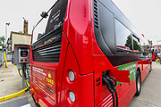 """London, United Kingdom, July 10, 2021: TFL electric bus appears to be charging at a station near Waterloo on Saturday, July 10, 2021. TfL continues to roll out electric buses, with plans for 2,000 all-electric buses to be in operation by 2025. """"London's toxic air is a public health crisis causing premature deaths and stunting the growth of children's lungs,"""" said Mayor of London Sadiq Khan. (VX Photo/ Vudi Xhymshiti)"""