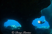 """scuba diver enters Skull Cave - a cavern formed by a lava tube opening on the shoreline at Kohanaiki, in the area formerly known as """"Pine Trees"""" in North Kona, Hawaii ( the Big Island ), USA ( Central Pacific Ocean ) MR 353"""