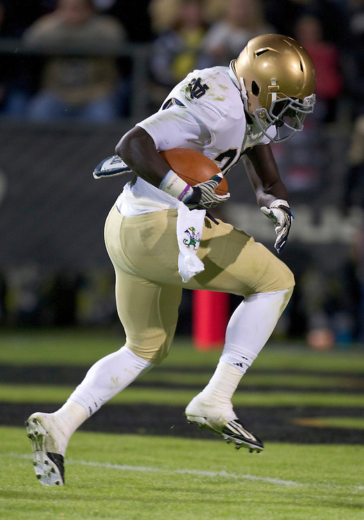 October 01, 2011:  Notre Dame running back Cierre Wood (#20) crosses the goal line for a touchdown during NCAA Football game action between the Notre Dame Fighting Irish and the Purdue Boilermakers at Ross-Ade Stadium in West Lafayette, Indiana.  Notre Dame defeated Purdue 38-10.