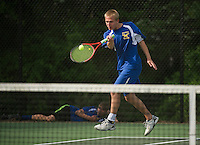 Nolan Dwyer of Gilford returns a shot from Aditya Shah of Bow during their singles match on Tuesday afternoon.  (Karen Bobotas/for the Laconia Daily Sun)