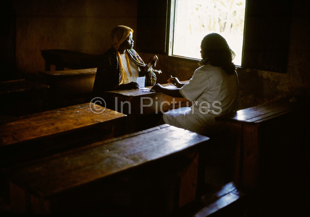 A woman is given the results of her HIV test at Kibayi Health centre. Kibileze, Rwanda.