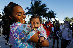 February 2, 2020, Miami Gardens, FL, USA: Sydnie Russell holds Mila Mathieu, the daughter of Kansas City Chiefs safety Tyrann Mathieu, before the Chiefs face off against the San Francisco 49ers in Super Bowl LIV at Hard Rock Stadium in Miami Gardens, Fla., on Sunday, Feb. 2, 2020. (Credit Image: © TNS via ZUMA Wire)