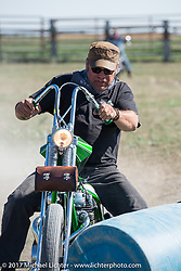Bill Stevens of Grand Rapids was the rodeo winner on his custom 1968 Yamaha SX-650 chopper at the Run to the Line Bikers vs Cowboys rodeo games at the Spur Creek Ranch in Newell during the annual Sturgis Black Hills Motorcycle Rally.  SD, USA. Wednesday August 9, 2017. Photography ©2017 Michael Lichter.