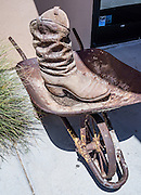 A cowboy boot in a wheelbarrow greets visitor to the fascinating Museum of Western Film History, 701 S. Main Street, Lone Pine, California, 93545, USA. (Formerly called the Beverly and Jim Rogers Museum of Lone Pine Film History.) Web site: www.lonepinefilmhistorymuseum.org