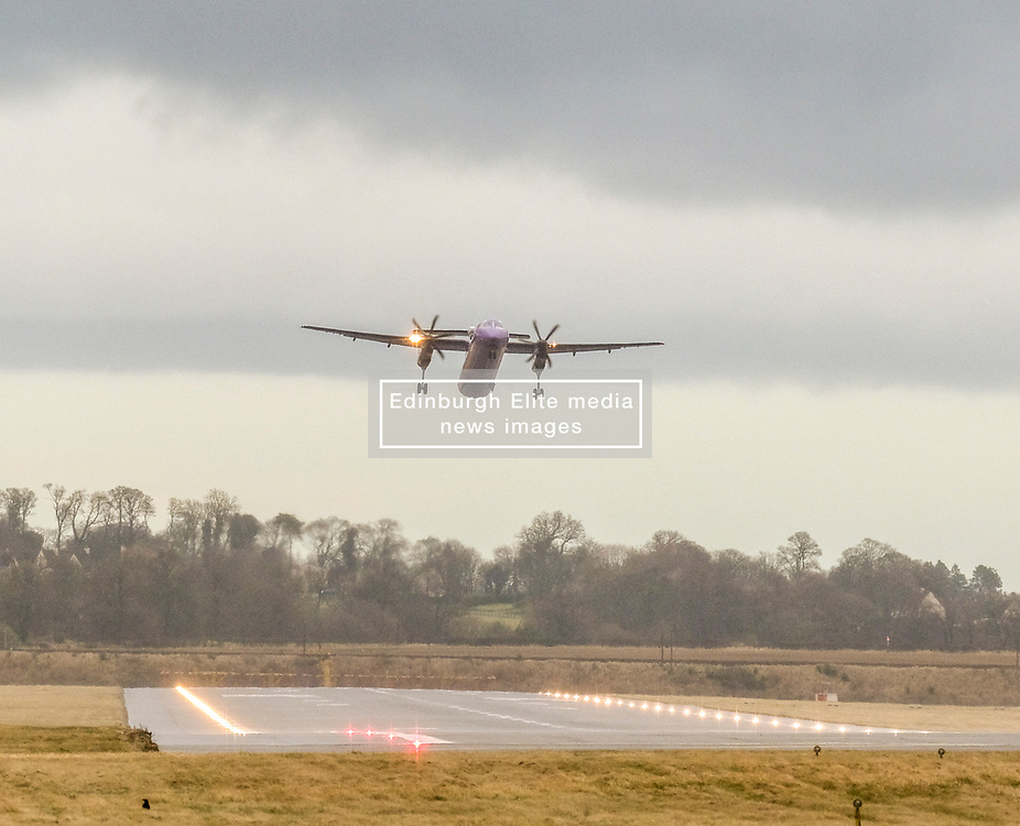 High Winds at Edinburgh Airport, Tuesday 7th January 2020<br /> <br /> Planes struggled on landing and take-off as high winds hit Edinburgh Airport today<br /> <br /> Pictured: A Flybe flight takes off<br /> <br /> Alex Todd   Edinburgh Elite media