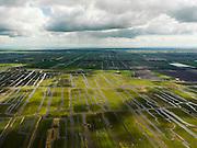 Nederland, Noord-Holland, Gemeente Schermer, 16-04-2012; Grootschermer met in de voorgrond de  Eilandspolder. Kenmerkend voor polder is de onregelmatige verkaveling en deze staat in contrast met de beroemde geometrische verkaveling van de e Beemster in de achtergrond. Foto richting oostelijke richting, aan de horizon buien boven het IJsselmeer..De Beemster, een 17e eeuwse droogmakerij, is werelderfgoed (Unesco werelderfgoedlijst), de Eilandspolder is een vaarland of vaarpolder (landerijen niet bereikbaar via de weg). Natura 2000 laagveen natuurgebied. . .This polder Schermer has an irregular land division in contrast to the famous geometrical well-ordered polder Beemster, 17th century  reclaimed landscape, Unesco world heritage..luchtfoto (toeslag), aerial photo (additional fee required);.copyright foto/photo Siebe Swart