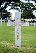 The grave of Dale E. Christensen, who was awarded the Medal of Honor for actions in New Guinea during World War II. He is one of more than 17,000 soldiers buried at the Manila American Cemetery in Manila, Philippines