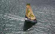 The 2013 Rolex Fastnet race start. Cowes. UK<br /> Pictures of the IMOCA Open60 MACIF skippered by François Gabart (FRA) with Michel Desjoyeaux (FRA) . Shown here as they race down the Solent <br /> Credit: Lloyd Images