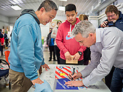 "24 JANUARY 2020 - POLK CITY, IOWA: JOE WALSH signs a banner for a man during a campaign event in Polk City, northwest of Des Moines. Walsh, a conservative radio personality, former Republican congressman, and one time supporter of Donald Trump is now challenging Trump for the Republican nomination for the US Presidency. During his appearance in Polk City, Walsh said Trump is unfit to be the President because he is a ""cheater,"" a climate change denier, and a ""threat"" to the United States.     PHOTO BY JACK KURTZ"