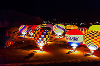 Evening balloon glow, Red Rock Balloon Rally, Red Rock State Park, near Gallup, New Mexico USA.