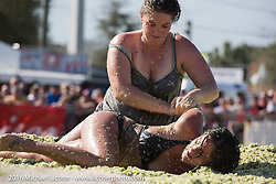 Nikki Panagakos and Lindsey Rader in the pit at the Womens Cole Slaw Wrestling at Sopotnicks Cabbage Patch Bar, New Smyrna Beach, during Daytona Bike Week's 75th Anniversary event. FL, USA. Saturday March 12, 2016.  Photography ©2016 Michael Lichter.