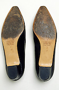pair of women?s shoes with worn soles