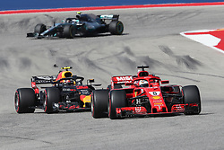 October 21, 2018 - Austin, TX, U.S. - AUSTIN, TX - OCTOBER 21: Ferrari driver Sebastian Vettel (5) of Germany leads Red Bull Racing driver Max Verstappen (33) of Netherlands into turn 13 as Mercedes driver Valtteri Bottas (77) of Finland races from behind during the F1 United States Grand Prix on October 21, 2018, at Circuit of the Americas in Austin, TX. (Photo by John Crouch/Icon Sportswire) (Credit Image: © John Crouch/Icon SMI via ZUMA Press)