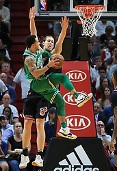 November 22, 2017 - Miami, FL, USA - The Miami Heat's Kelly Olynyk, top, fouls the Boston Celtics' Shane Larkin as he goes up to the basket in the fourth quarter at the AmericanAirlines Arena in Miami on Wednesday, Nov. 22, 2017. The Heat won, 104-98. (Credit Image: © Al Diaz/TNS via ZUMA Wire)