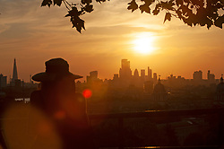 ©Licensed to London News Pictures 23/06/2020<br /> Greenwich, UK. A view of the sunset from Greenwich park, Greenwich,London this evening on the first day of a predicted heatwave. Photo credit: Grant Falvey/LNP