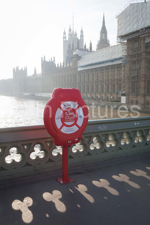 An emergency lifebuoy on Westminster Bridge, in front of the UK Houses of Parliament in Westminster, on 21st January 2019, in London England.