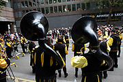 Band playing sousaphones taking part in the London Marathon on 28th April 2019 in London, England, United Kingdom. The London Marathon, presently known through sponsorship as the Virgin Money London Marathon, is a long-distance running event. The event was first run in 1981 and has been held in the spring of every year since. The race is mainly known for ebing a public race where ordinary people can challenge themsleves while raising great amounts of money for various charities.