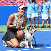 JESSICA PEGULA celebrates winning the 2019 Citi Open with her dog Maddie.
