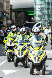 Metropolitan Police Officers arrive to prepare for the demonstration by London Black Cab drivers as they protest over the refusal to place a Black Cab taxi rank outside the entrance to The Shard. May 2013 London