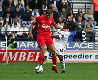 Photo. Andrew Unwin.<br /> Bolton Wanderers v Liverpool, Barclays Premiership, Reebok Stadium, Bolton 29/08/2004.<br /> Bolton's Jay Jay Okocha (R) tries to tackle Liverpool's Steven Gerrard (L)<br /> NORWAY ONLY