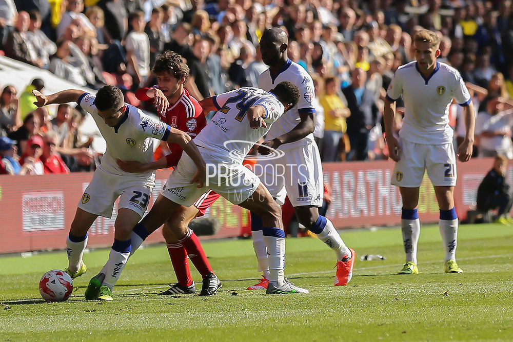 Leeds United midfielder Lewis Cook   and Middlesbrough forward, on loan from Watford, Diego Fabbrini fight for the ball during the Sky Bet Championship match between Middlesbrough and Leeds United at the Riverside Stadium, Middlesbrough, England on 27 September 2015. Photo by Simon Davies.