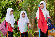"""Sept. 27, 2009 -- PATTANI, THAILAND: Muslim girls on their way to school in Pattani, Thailand, Sept 27. Schools and school teachers have been frequent targets of Muslim insurgents in southern Thailand and the army now provides security at many government schools.  Thailand's three southern most provinces; Yala, Pattani and Narathiwat are often called """"restive"""" and a decades long Muslim insurgency has gained traction recently. Nearly 4,000 people have been killed since 2004. The three southern provinces are under emergency control and there are more than 60,000 Thai military, police and paramilitary militia forces trying to keep the peace battling insurgents who favor car bombs and assassination.  Photo by Jack Kurtz / ZUMA Press"""