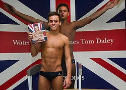 © Licensed to London News Pictures. 21/04/2011 London, UK. Olympic diving hopeful Tom Daley poses before a book signing event on his eighteenth birthday at Waterstone's. Piccadilly. London. Photo credit : Simon Jacobs/LNP