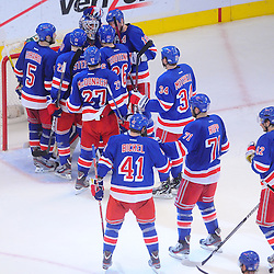May 14, 2012: The New York Rangers line up to congratulate goalie Henrik Lundqvist (30) on his shutout victory in game 1 of the NHL Eastern Conference Finals between the New Jersey Devils and New York Rangers at Madison Square Garden in New York, N.Y. The Rangers defeated the Devils 3-0.
