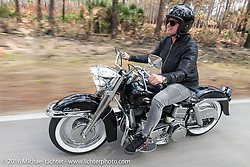 Shelly Rossmeyer of Rossmeyer Harley Davidson riding through Tomoka State Park during Daytona Bike Week 75th Anniversary event. FL, USA. Thursday March 3, 2016.  Photography ©2016 Michael Lichter.