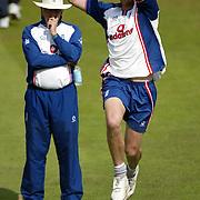 Steve Harmison practises bowling in the nets infront of coach Duncan Fletcher