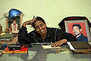 Geetan Jali Panda, 34, the wife of Biranchi Das, the recently murdered coach of Budhia Singh, is remembering her time along his husband while sitting in her office near one of his pictures (right), in Bhubaneswar, the capital of Orissa State, on Saturday, May 17, 2008. On May 1, 2006, Budhia completed a record breaking 65 km run from Jagannath temple, Puri to Bhubaneswar. He was accompanied by his coach Biranchi Das and by the Central Reserve Police Force (CRPF). On 8th May 2006, a Government statement had ordered that he stopped running. The announcement came after doctors found the boy had high blood pressure and cardiological stress. As of 13th August 2007 Budhia's coach Biranchi Das was arrested by Indian police on suspicion of torture. Singh has accused his coach of beating him and withholding food. Das says Singh's family are making up charges as a result of a few petty rows. On April 13, Biranchi Das was shot dead in Bhubaneswar, in what is believed to be an event unconnected with Budhia, although the police is investigating the case and has made an arrest, a local goon named Raja Archary, which is now in police custody. **Italy and China Out**
